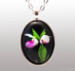 two showy lady slippers photo set in silver pendant