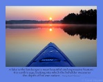 blue kayak perspective on lake with Henry David Thoreau quote